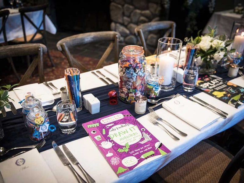 Kids table with lollies and activity books