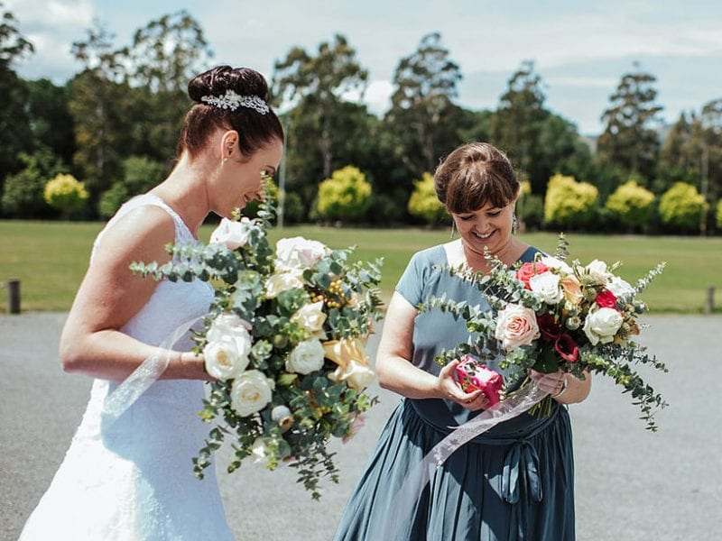 Bride and bridesmaid with bouquets by Kim Chan Events