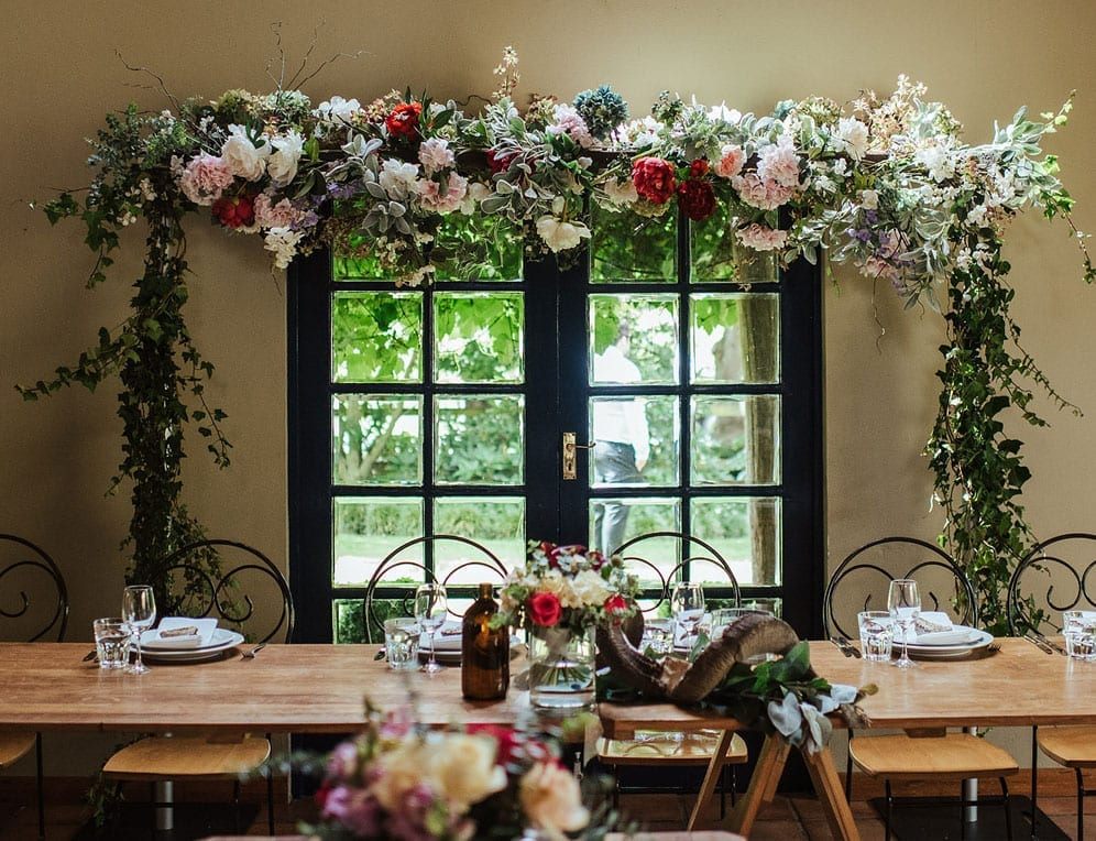Head table floral decorations by Kim Chan Events