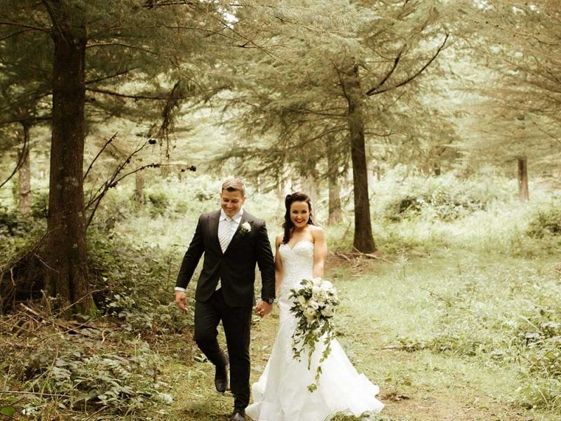 Bride and groom in the woods for their photos