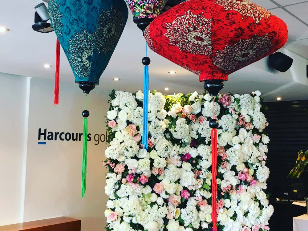 Harcourts Gold flower wall with lights